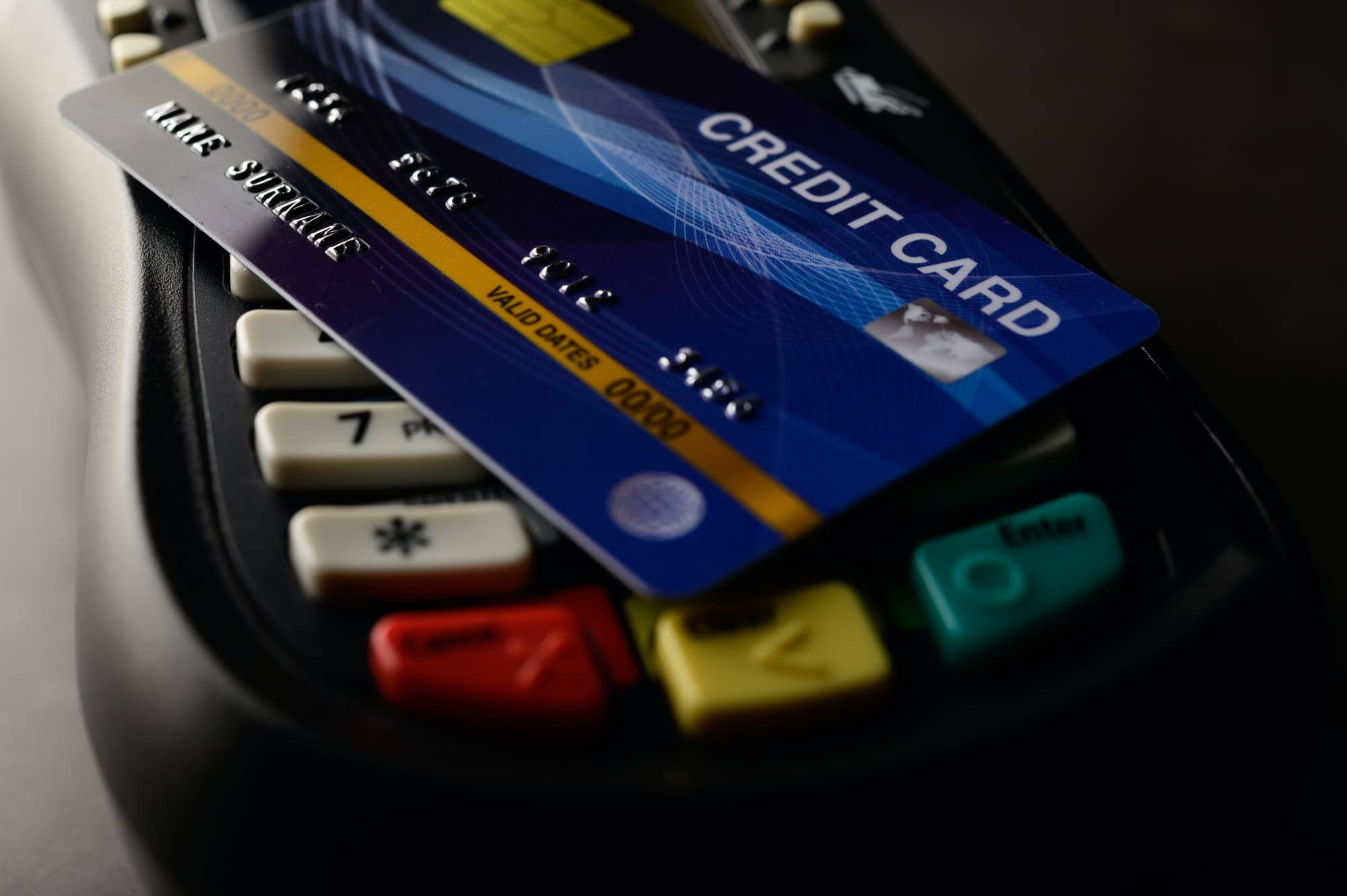 Credit cards placed on credit card swipes